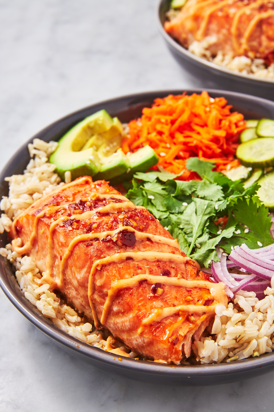"""<p>The grain bowl of your dreams.</p><p>Get the recipe from <a href=""""https://www.delish.com/cooking/recipe-ideas/a26950912/spicy-salmon-bowl-recipe/"""" rel=""""nofollow noopener"""" target=""""_blank"""" data-ylk=""""slk:Delish"""" class=""""link rapid-noclick-resp"""">Delish</a>.</p>"""