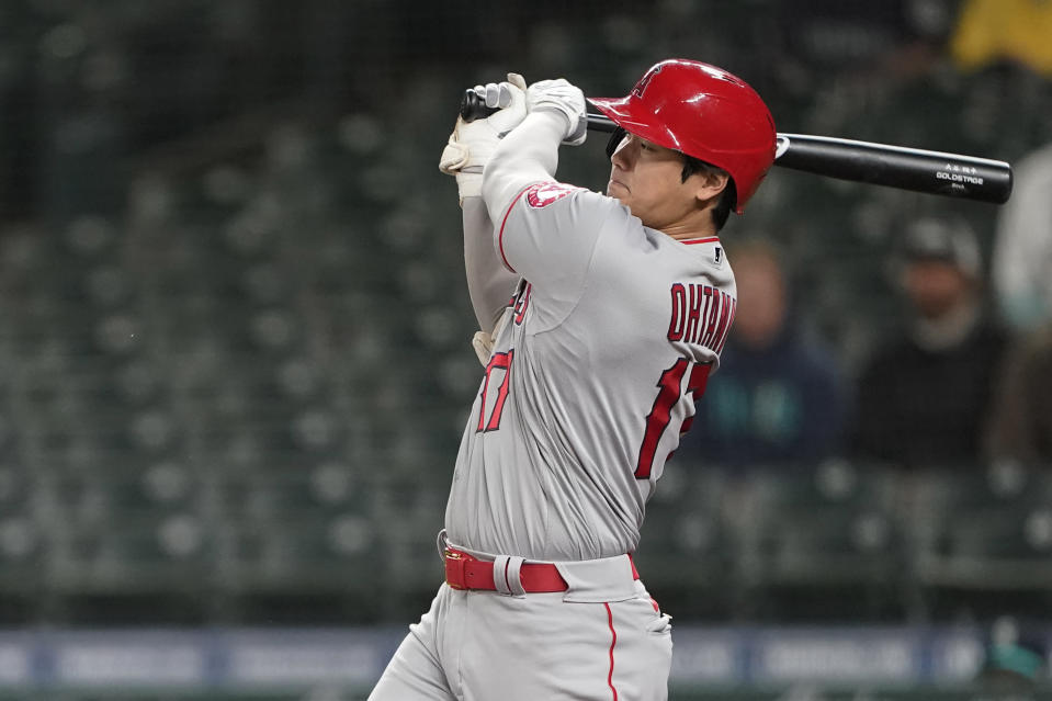 Los Angeles Angels' Shohei Ohtani grounds out to end the top of the eighth inning of the team's baseball game against the Seattle Mariners, Friday, April 30, 2021, in Seattle. The Mariners won 7-4. (AP Photo/Ted S. Warren)