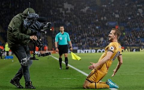 Tottenham Hotspur's English striker Harry Kane celebrates in front of a TV camera - Credit:  ADRIAN DENNIS/AFP