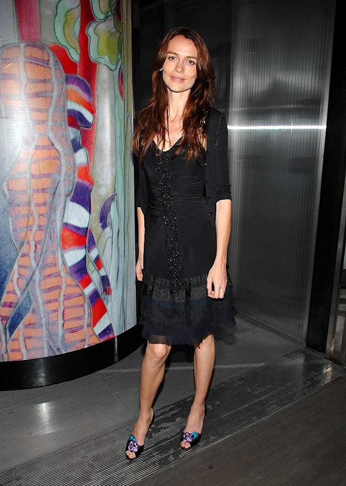 """Saffron Burrows, who currently stars in the """"Bank Job,"""" opts to wear a basic black ensemble from Prada. John Shearer/<a href=""""http://www.wireimage.com"""" target=""""new"""">WireImage.com</a> - March 19, 2008"""