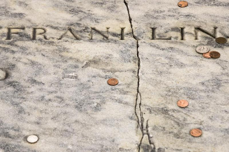 A crack runs through Benjamin Franklin's a gravestone at the Christ Church Burial Ground in Philadelphia, Tuesday, Nov. 15, 2016. A fundraising campaign has been launched to save Franklin's damaged gravestone. (AP Photo/Matt Rourke)