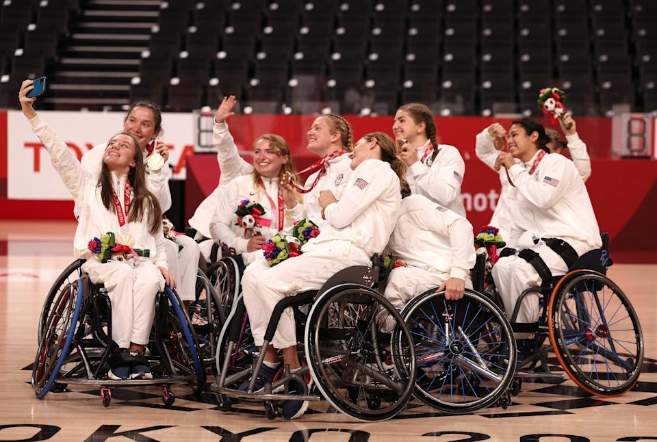 American Wheelchair Basketball players pose with their bronze medals from the Tokyo Paralympics.