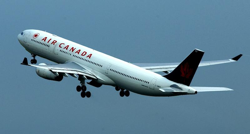 An Air Canada passenger has told of waking up alone in a dark plane after falling asleep on the flight.