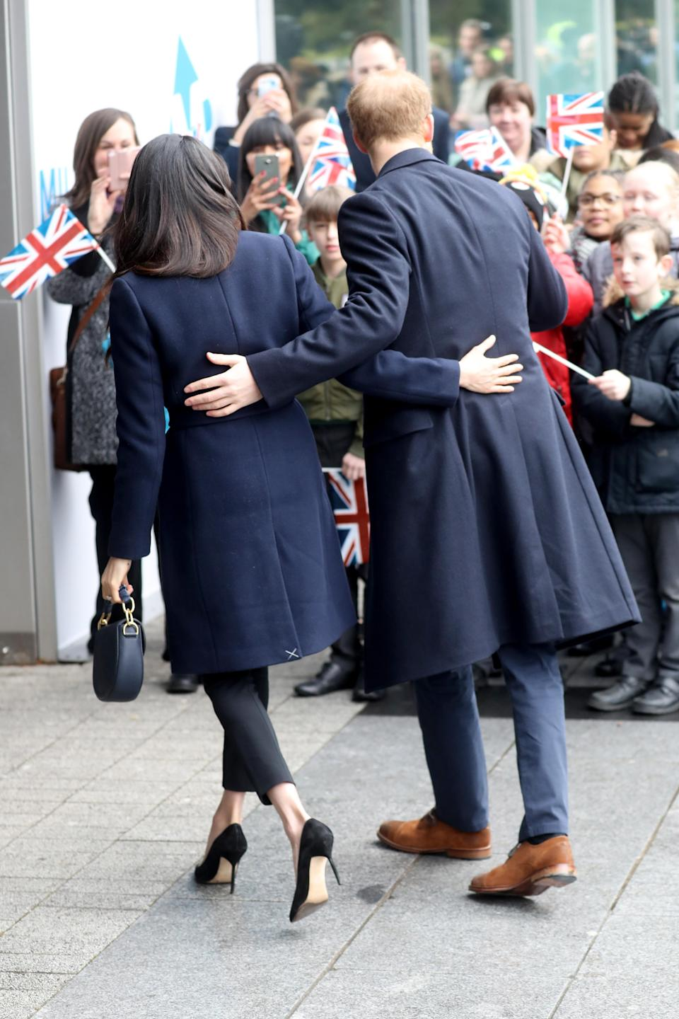 "Notice the ""X"" on the bottom of Meghan's coat? That's a tailor tack. <i>(Getty Images)</i>"