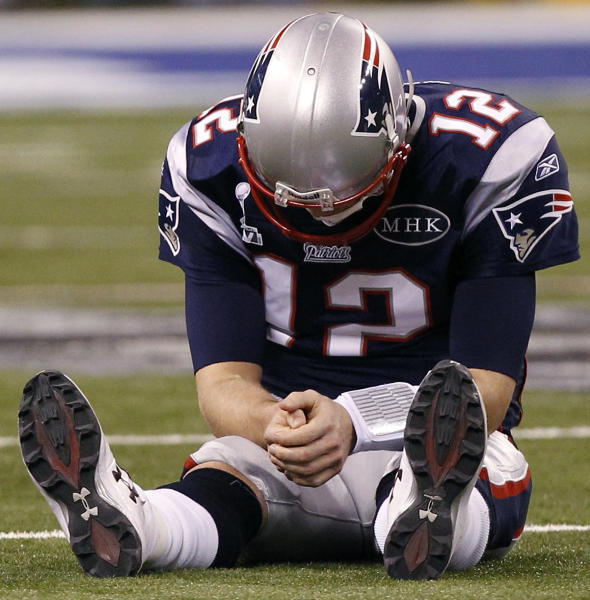 FILE - In this Feb. 5, 2012 file photo, New England Patriots quarterback Tom Brady reacts after New York Giants linebacker Chase Blackburn intercepted Brady's pass intended for tight end Rob Gronkowski during the fourth quarter of the NFL Super Bowl XLVI football game in Indianapolis. Brady nearly made a play that might have slammed the door on the Giants, but Blackburn's pick gave the team new life and eventually a 21-17 win. (AP Photo/Paul Sancya, File)
