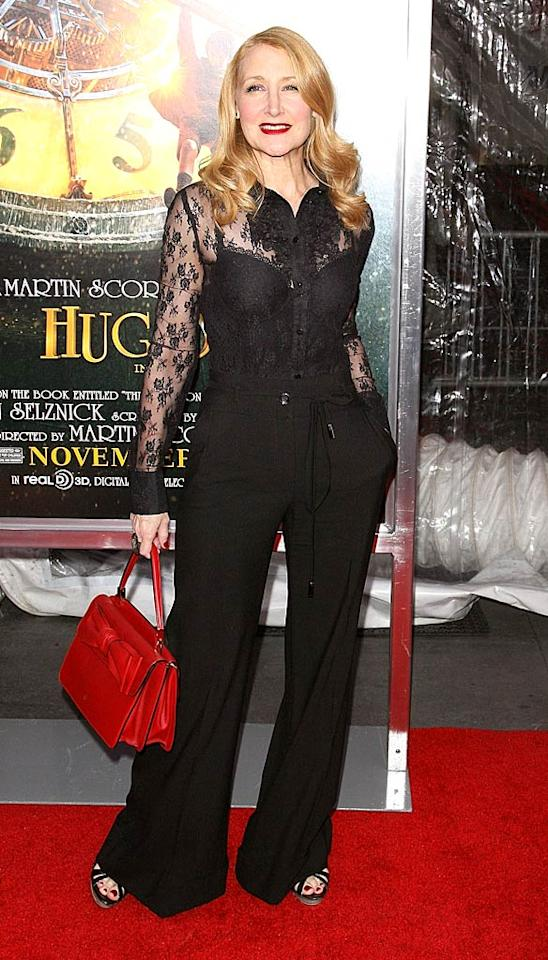 "Not only is Patricia Clarkson one of the best actresses in Hollywood, she's also one of the most stylish. The 51-year-old screen star put women half her age to shame as she arrived at the NYC premiere of ""Hugo"" in a lace top, flared trousers, and strappy heels. Red lips, nails, and a matching handbag completed her flawless look. (11/21/2011)"