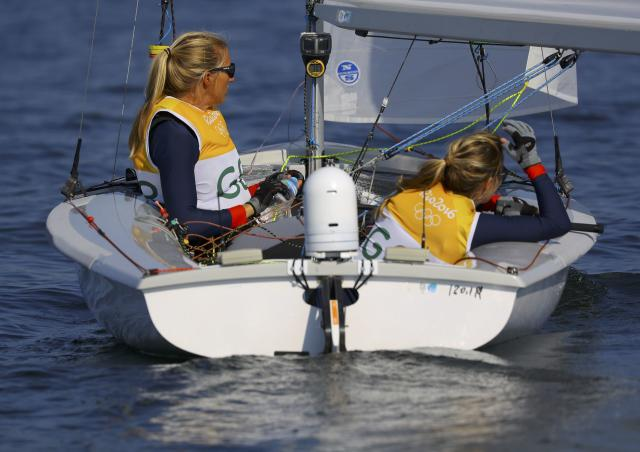 2016 Rio Olympics - Sailing - Final - Women's Two Person Dinghy - 470 - Medal Race - Marina de Gloria - Rio de Janeiro, Brazil - 17/08/2016. Hannah Mills (GBR) of Britain and Saskia Clark (GBR) of Britain wait for the start of the race. REUTERS/Brian Snyder FOR EDITORIAL USE ONLY. NOT FOR SALE FOR MARKETING OR ADVERTISING CAMPAIGNS.