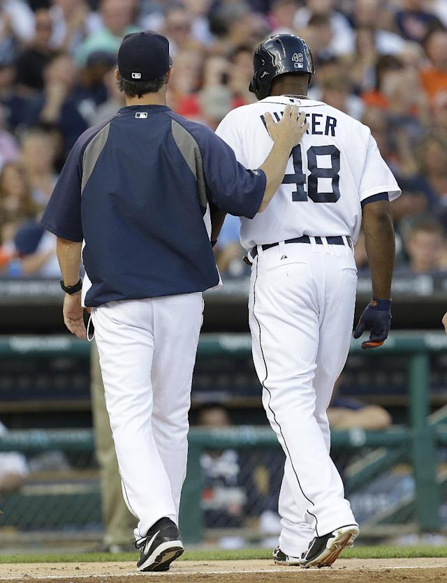 Detroit Tigers manager Brad Ausmus puts his hand on Torii Hunter's back as they head to the dugout after Hunter hit a single against the Kansas City Royals in the fourth inning of a baseball game in Detroit, Monday, June 16, 2014. (AP Photo/Paul Sancya)