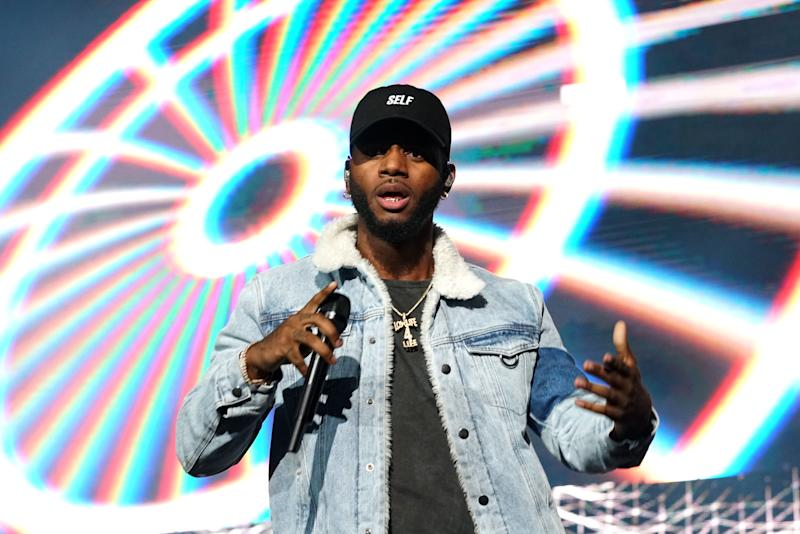 Bryson Tiller performs on stage