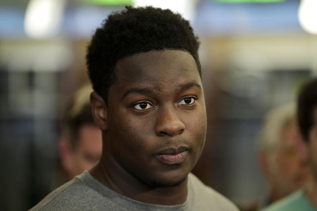 New York Jets' Folorunso Fatukasi, who was drafted in the sixth round of the draft, talks to reporters during NFL rookie camp, Saturday, May 5, 2018, in Florham Park, N.J. (AP Photo/Julio Cortez)