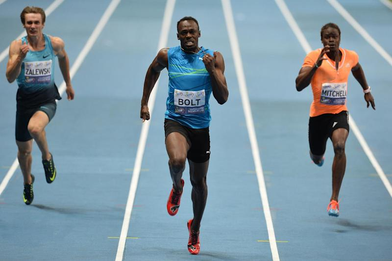 The Jamaican sprinter, Usain Bolt competes with Poland's Karol Zalewski (L) and Jamaican's Sheldon Mitchell (R) at the National stadium in Warsaw, Poland on August 23, 2014