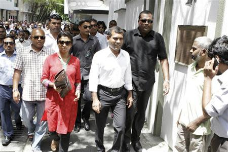 Former Maldives President Nasheed walks to the Indian High Commission with his supporters and party members in Male