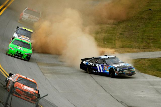 TALLADEGA, AL - OCTOBER 23: Denny Hamlin, driver of the #11 FedEx Office Toyota, loses control of his car during the NASCAR Sprint Cup Series Good Sam Club 500 at Talladega Superspeedway on October 23, 2011 in Talladega, Alabama. (Photo by Jared C. Tilton/Getty Images for NASCAR)