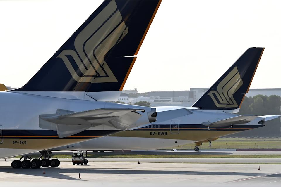 This photograph taken on March 16, 2020 shows Singapore Airlines planes parked on the tarmac at Changi International Airport in Singapore. - Singapore Airlines announced on March 23 that it was cutting 96 per cent of its capacity till the end of April due to the COVID-19 novel coronavirus. (Photo by Roslan RAHMAN / AFP) (Photo by ROSLAN RAHMAN/AFP via Getty Images)