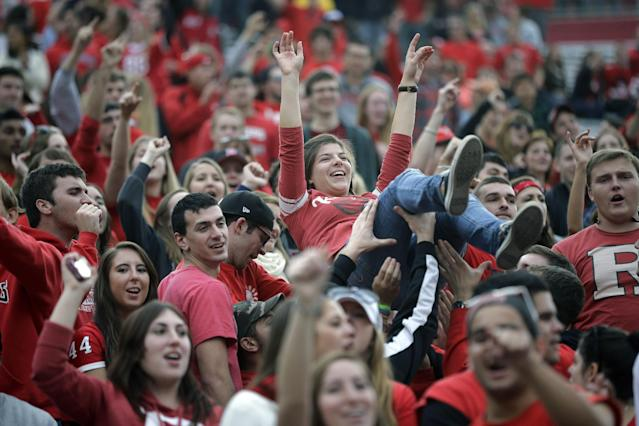 Rutgers fans celebrate near the end of the second half of an NCAA college football game against Temple in Piscataway, N.J. Saturday, Nov. 2, 2013. Rutgers won 23-20. (AP Photo/Mel Evans)