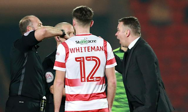 Darren Ferguson (right), exchanges words with referee Andy Haines at the end of the draw with Plymouth.