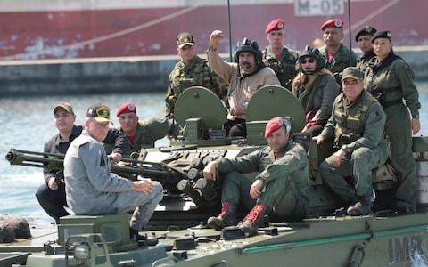 <span>Nicolas Maduro in a tank with his troops, on Wednesday</span>