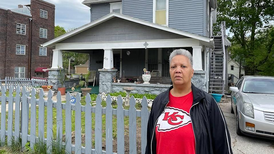 Ellen Betts stands in front of the Kansas City, Kansas, house where her son and two nephews were staying when they were wrongly accused of murdering KCK police detective Roger Golubski's 17-year-old nephew.