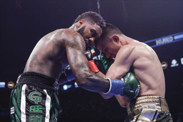 Jarret Hurd, left, lands a body shot on Francisco Santana during the seventh round of a super welterweight boxing match Saturday, Jan. 25, 2020, in New York. Hurd won the fight. (AP Photo/Frank Franklin II)