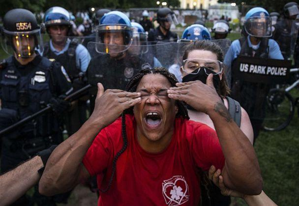 PHOTO: A woman reacts to being hit with pepper spray as protesters clash with police after they attempted to pull down the statue of former U.S. President Andrew Jackson in Lafayette Square near the White House in Washington, D.C., on June 22, 2020. (Tasos Katopodis/Getty Images)