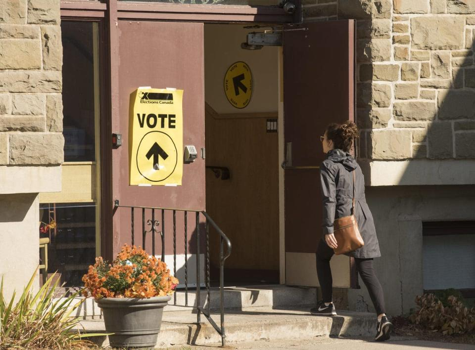 A woman walks into a church to vote