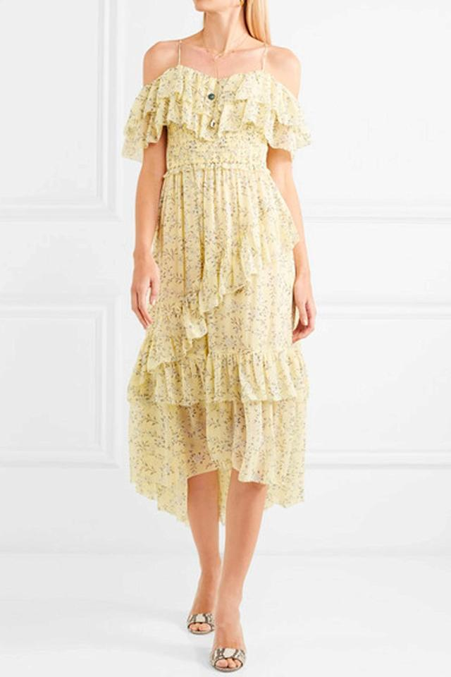 "<p><a rel=""nofollow"" href=""https://www.net-a-porter.com/us/en/product/1039303/Ulla_Johnson/penninah-cold-shoulder-ruffled-floral-print-silk-georgette-dress"">BUY NOW</a> <em>Ulla Johnson Floral-print Silk-georgette Dress, $690</em></p>"