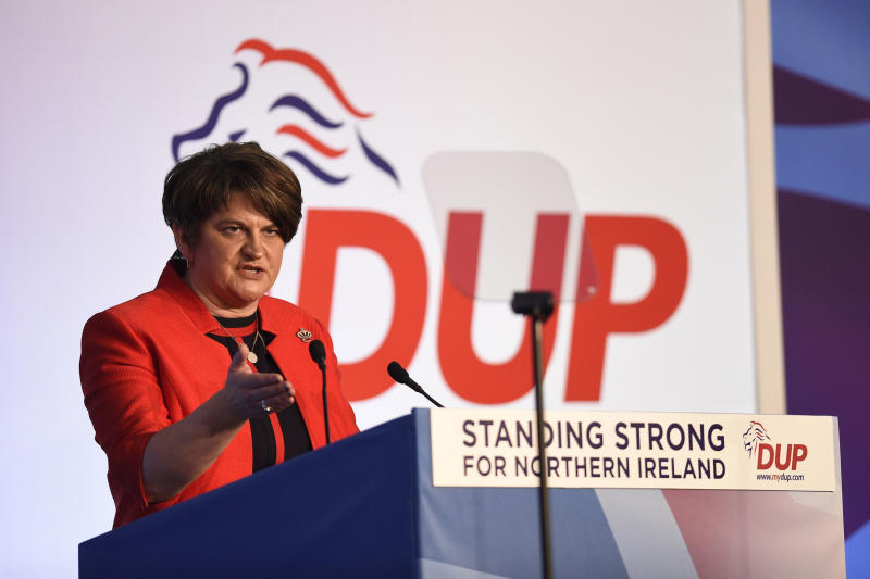 Party leader Arlene Foster speaking during the DUP annual conference at the Crown Plaza Hotel in Belfast, Saturday, Nov. 24, 2018. The leader of Northern Ireland's Democratic Unionist Party has used her keynote speech at the annual conference to reject the British government's planned Brexit deal. Arlene Foster said in Belfast on Saturday that the deal agreed by Prime Minister Theresa May is unacceptable and must be improved upon in the weeks ahead. (Michael Cooper/PA via AP)