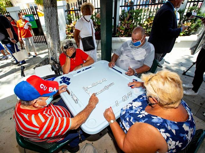 People are able to play dominoes again at Domino Park in the Little Havana neighborhood of Miami, Florida, on May 3, 2021.