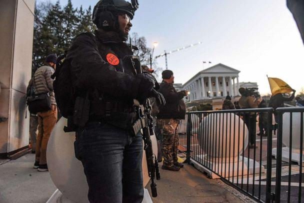 PHOTO: A person carrying a gun stands near the Virginia State Capitol building to advocate for gun rights in Richmond, Va. Jan. 20, 2020. (Stephanie Keith/Reuters)