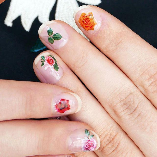 "<p>What to do if nail art is just too much effort but you still want a badass Valentine's Day mani? Get yourself a bunch of floral stickers and paint over the top with clear varnish of course.</p><p><a href=""https://www.instagram.com/p/BTLISJRhU5N"" rel=""nofollow noopener"" target=""_blank"" data-ylk=""slk:See the original post on Instagram"" class=""link rapid-noclick-resp"">See the original post on Instagram</a></p>"