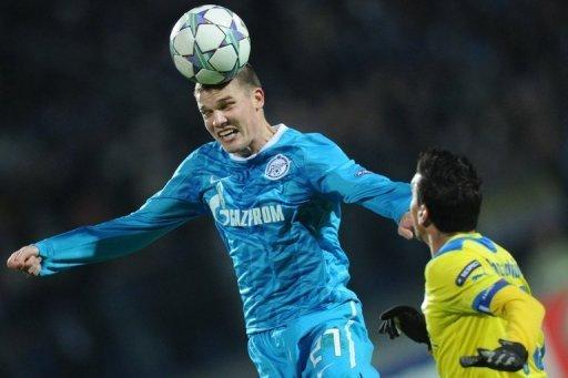 Igor Denisov (L) of Zenit St Petersburg fights for the ball against Constantinos Charalambides of APOEL FC during a UEFA Champions League match in Saint-Petersburg, 2011. Zenit Saint Petersburg midfielder Igor Denisov has branded new signing Hulk a second-rate star after being demoted from the first team for speaking out about the Brazilian striker's lucrative contract