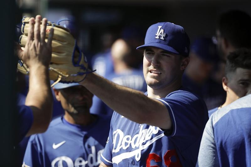Los Angeles Dodgers starting pitcher Ross Stripling is greeted in the dugout.
