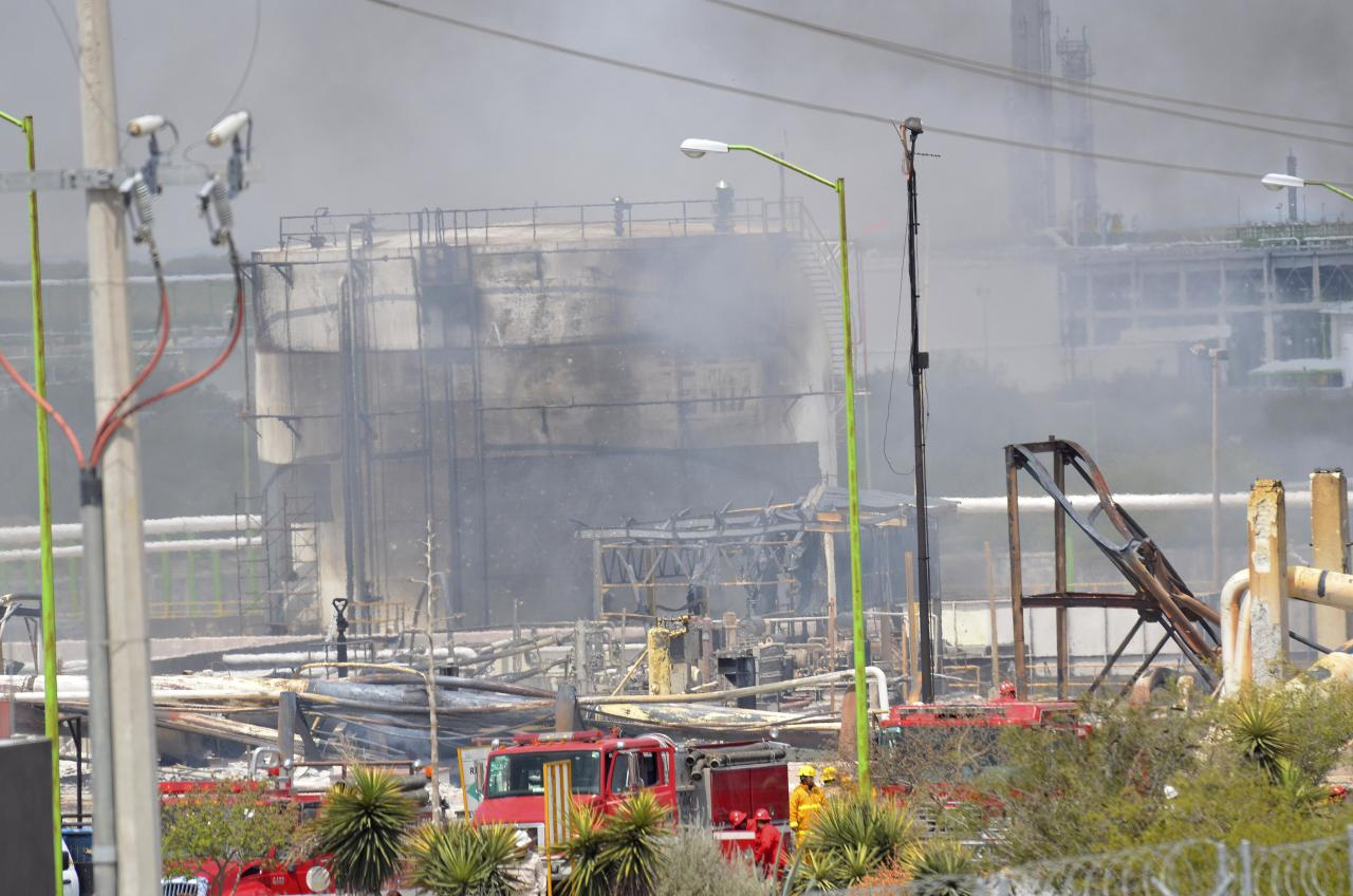 Damaged structures can be seen after an explosion ripped through a gas pipeline distribution center in Reynosa, Mexico near Mexico's border with the United States, Tuesday Sept. 18, 2012. Mexico's state-owned oil company, Petroleos Mexicanos, also known as Pemex said the fire had been extinguished and the pipeline had been shut off but ten people were killed during the incident. (AP Photo/El Manana de Reynosa)