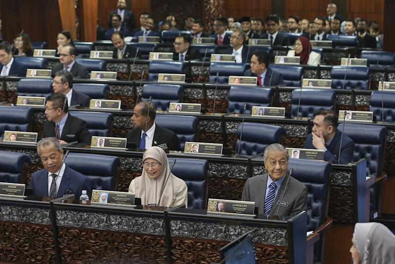 Tun Dr Mahathir Mohamad (right) is seen at the second meeting of the first session of the 14th Parliament in Kuala Lumpur October 15, 2018. ― Picture by Azneal Ishak