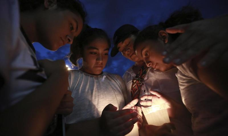 People gather in Juarez, Mexico, 3 August 2019, in a vigil for the Mexican nationals who were killed in an El Paso shopping-complex shooting.