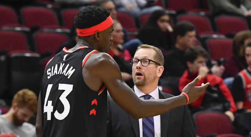 Toronto Raptors head coach Nick Nurse talks with Toronto Raptors forward Pascal Siakam (43) during the second half of an NBA basketball game against the Chicago Bulls Saturday Oct. 26, 2019, in Chicago. (AP Photo/Matt Marton)