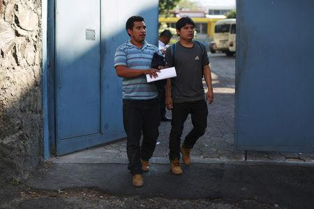 Deportees walk out at an immigration facility after a flight carrying illegal immigrants from the U.S. arrived in San Salvador, El Salvador, January 11, 2018. Picture taken January 11, 2018. REUTERS/Jose Cabezas