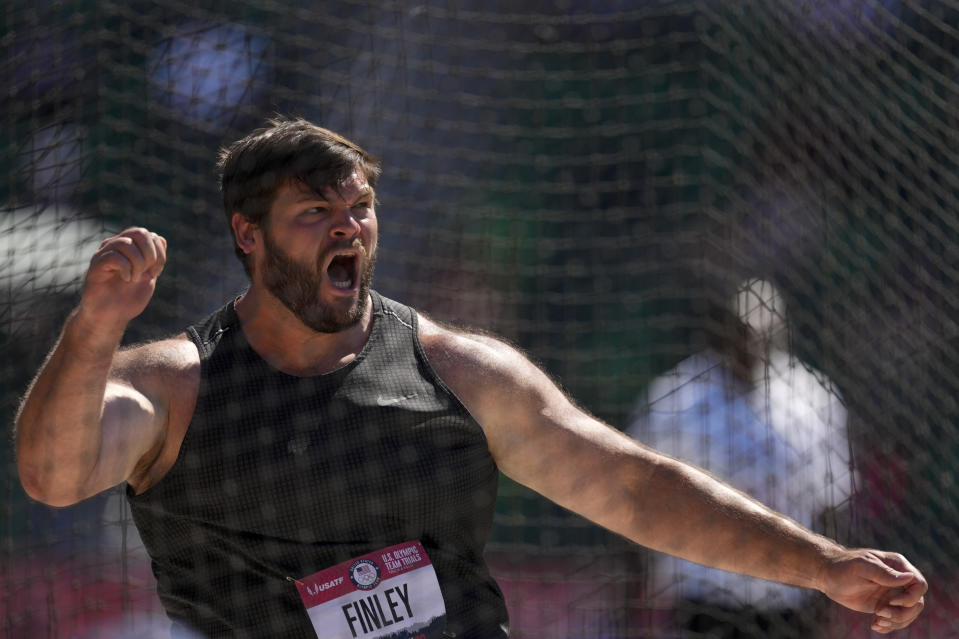 Mason Finley celebrates during the finals of men's discus throw at the U.S. Olympic Track and Field Trials Friday, June 25, 2021, in Eugene, Ore. (AP Photo/Charlie Riedel)
