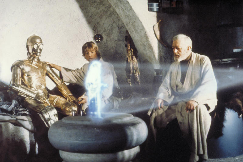 "** FOR ONE-TIME-USE-ONLY WITH MALCOLM RITTER'S STORY SLUGGED: VIDEO IN 3-D ** In this publicity image released by LucasFilm Ltd & TM, characters, from left, Anthony Daniels  portraying C-3PO, Mark Hamill portraying Luke Skywalker and Alec Guinness portraying Ben Obi-Wan Kenobi look at a hologram of Princess Leia, portrayed by Carrie Fisher in a scene from the original 1977 ""Star Wars"" film. (AP Photo/Lucasfilm Ltd & TM) ** NO SALES, ARCHIVE OUT, MUST CONTACT LUCASFILM FOR ADDITIONAL USE **"