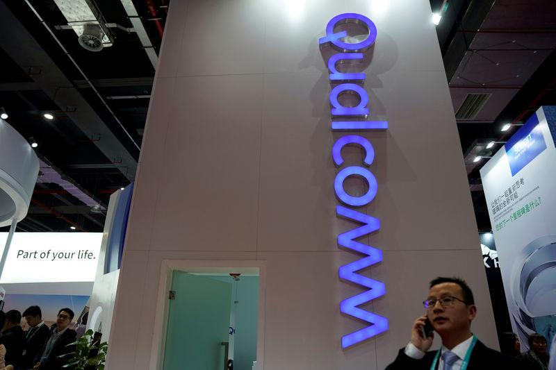 FILE PHOTO: A Qualcomm sign is seen during the China International Import Expo (CIIE), at the National Exhibition and Convention Center in Shanghai,