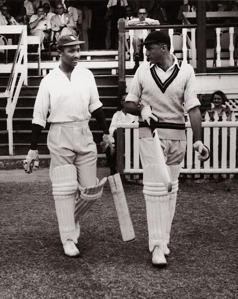 Team captain Jeffrey Stollmeyer (1921 - 1989, right) and his deputy Frank Worrell (1924 - 1967) go out to open the first innings for the West Indian team in the third Test Match against England at Georgetown, British Guiana, 4th March 1954. England won by nine wickets. (Photo by Central Press/Hulton Archive/Getty Images)
