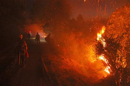 Monterey firefighters hold the line at the Rim Fire at night in this undated United States Forest Service handout photo near Yosemite National Park, California, released to Reuters August 30, 2013. REUTERS/Mike McMillan/U.S. Forest Service/Handout via Reuters