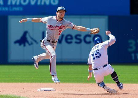Jun 17, 2018; Toronto, Ontario, CAN; Toronto Blue Jays left fielder Randal Grichuk (15) steals second base against Washington Nationals shortstop Trea Turner (7) during the seventh inning at Rogers Centre. Mandatory Credit: Kevin Sousa-USA TODAY Sports