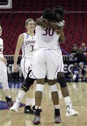 Stanford's Nnemkdadi Oguwike, back to the camera is hugged by her sister, Chiney Ogwumike as they walk off the court in the final moments of their win over Duke in the NCAA women's tournament regional final college basketball game, Monday, March 26, 2012, in Fresno, Calif. Stanford beat Duke 81-69 and is heading to the Final Four in Denver.(AP Photo/Rich Pedroncelli)