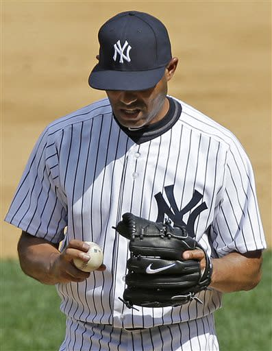 New York Yankees relief pitcher Mariano Rivera reacts after allowing a ninth-inning two-run home run to Baltimore Orioles' Adam Jones in a baseball game on Sunday, July 7, 2013, in New York. The Orioles won 2-1. (AP Photo/Kathy Willens)