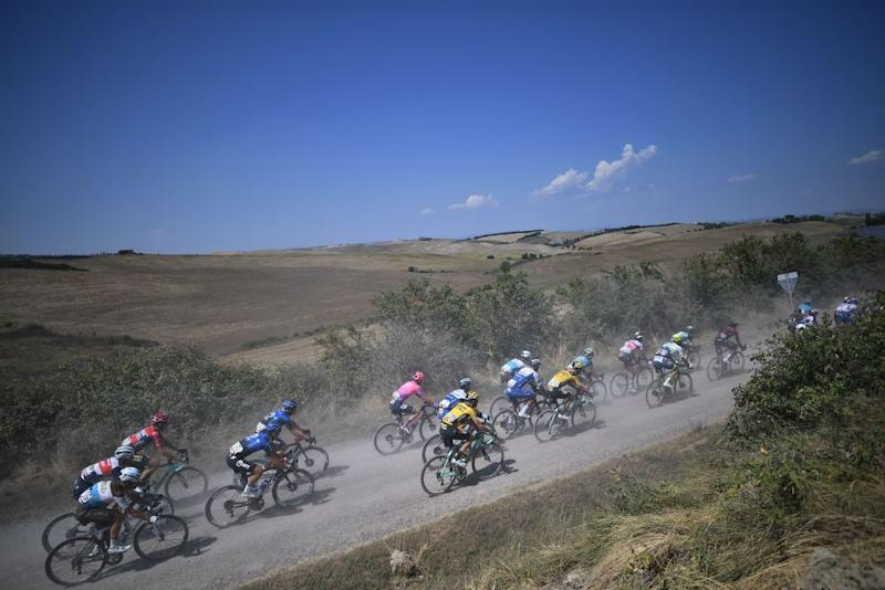 The pack of rider pedal through a dusty gravel road near Buonconverto during the oneday classic cycling race Strade Bianche White Roads on August 1 2020 around Siena Tuscany Photo by Marco Bertorello AFP Photo by MARCO BERTORELLOAFP via Getty Images