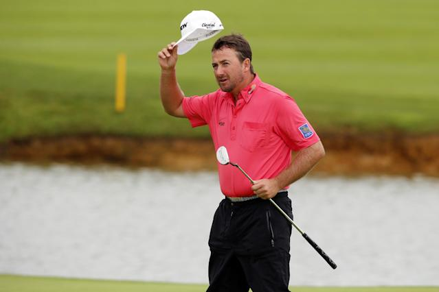 Graeme McDowell of Northern Ireland waves to the public on the 18th green to win the French Open Golf tournament at Paris National course in Guyancourt, west of Paris, France, Sunday, July 6, 2014. (AP Photo/Francois Mori)