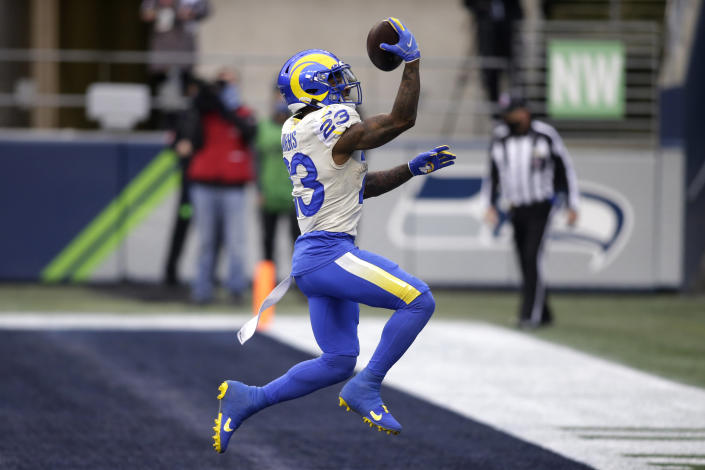 Los Angeles Rams running back Cam Akers reacts after scoring on a 5-yard run against the Seattle Seahawks during the first half of an NFL wild-card playoff football game, Saturday, Jan. 9, 2021, in Seattle. (AP Photo/Scott Eklund)