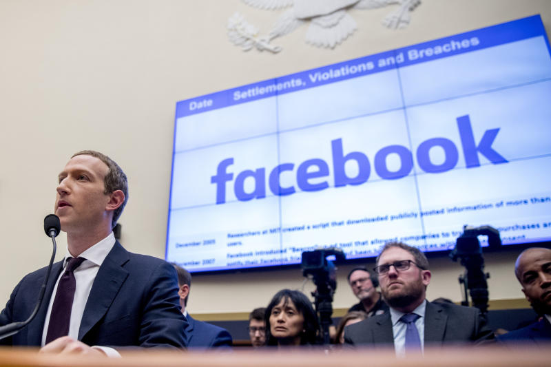 "File-This Oct. 23, 2019, file photo shows Facebook CEO Mark Zuckerberg testifying before a House Financial Services Committee hearing on Capitol Hill in Washington. Facebook's stock dropped almost 3% in regular trading after news reports Thursday, Dec. 12, 2019, suggested that the FTC may take antitrust action to prevent Facebook from integrating its disparate messaging apps. The reports said the Federal Trade Commission may seek a court injunction that would block Facebook's ""interoperability"" plans for Facebook Messenger, WhatsApp and Instagram, which involves revising them to use the same underlying software. (AP Photo/Andrew Harnik, File)"
