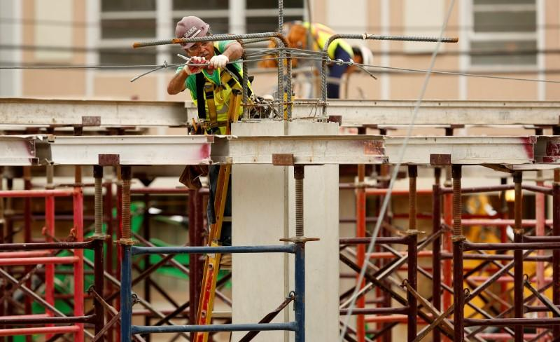 Constructions workers are seen at a new building site in Silver Spring, Maryland